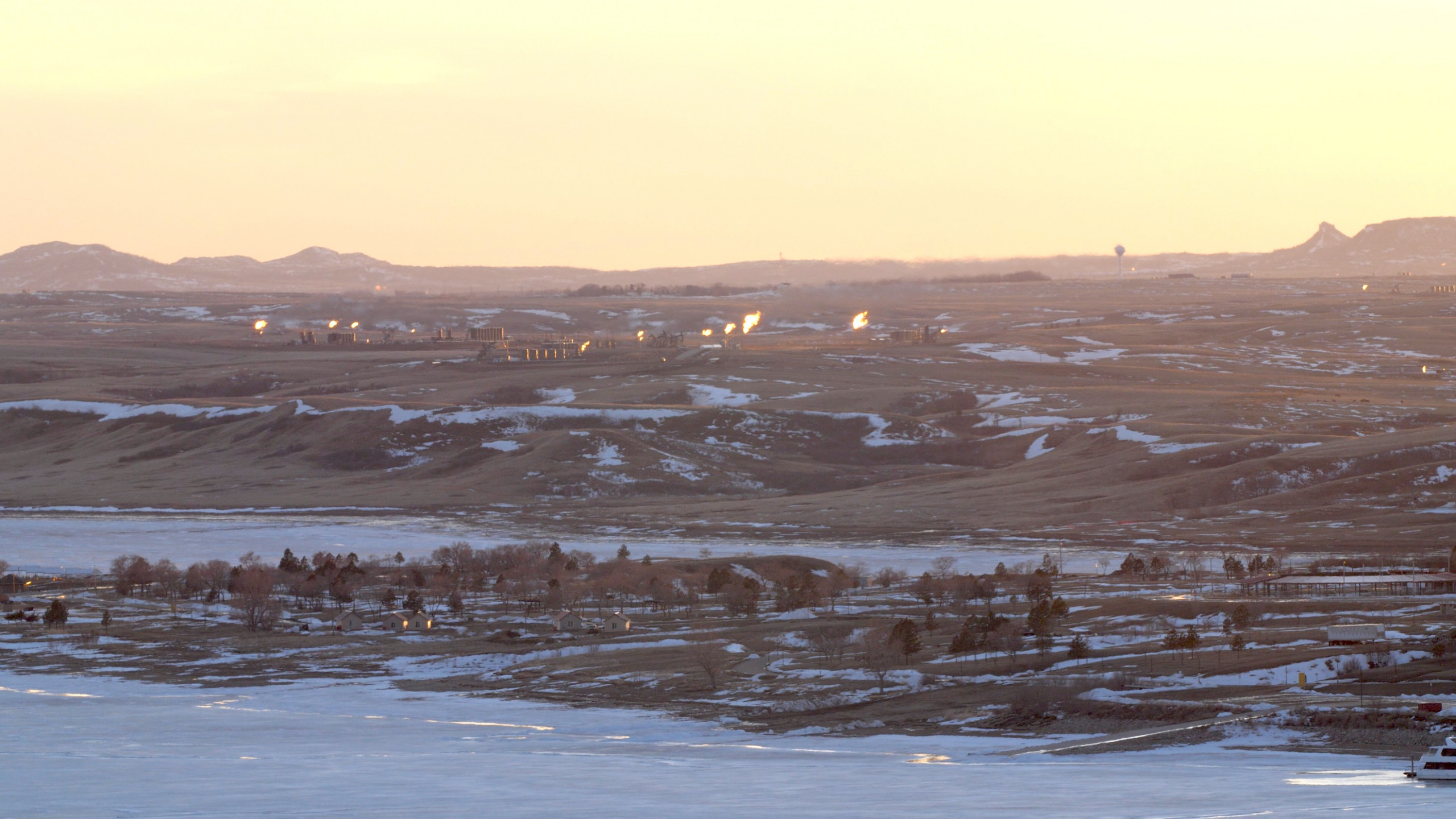 Natural gas flaring on the lands of the Mandan, Hidatsa and Arikara Nations. As seen from the bluffs overlooking the Missouri River across from Four Bears Village, MHA Nation, March 2019.  Photo: Angela Anderson